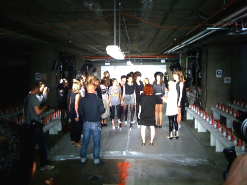 Models getting direction rundown for Pam Hogg LFW SS2010 show.  Show is being held in Central London at a carpark.